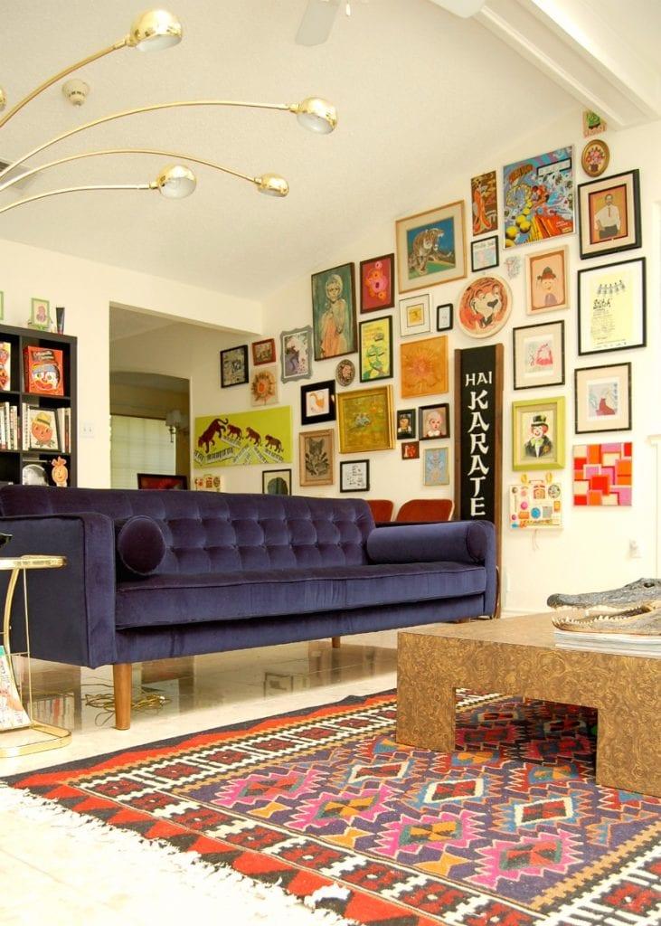 Jennifer Perkins gallery wall full of eclectic art.