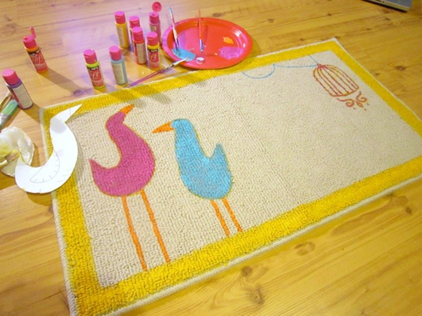 Painting the birds onto the DIY doormat by Jennifer Perkins