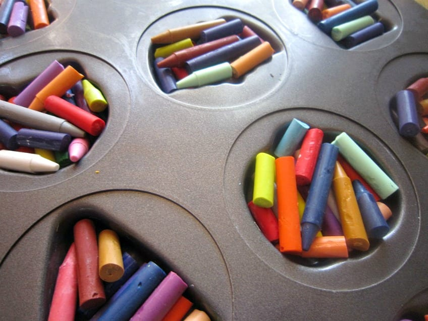 Broken crayons in a muffin tin