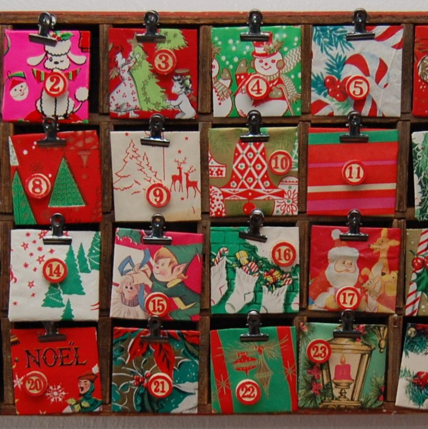 Advent calendar with vintage wrapping paper made from a Coke crate.