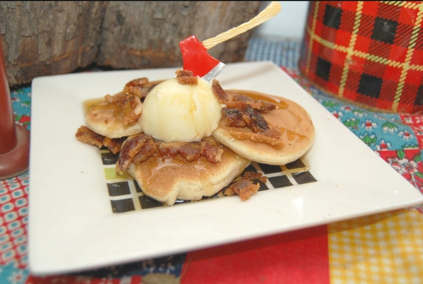 Pancakes with bacon and ice cream with an axe on top
