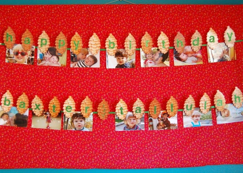 Pictures of kids on a bulletin board with pinecones