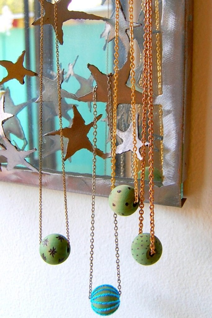 Dyed and wood burned beads by Jennifer Perkins