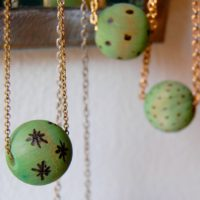 Wood burned and dyed beads by Jennifer Perkins