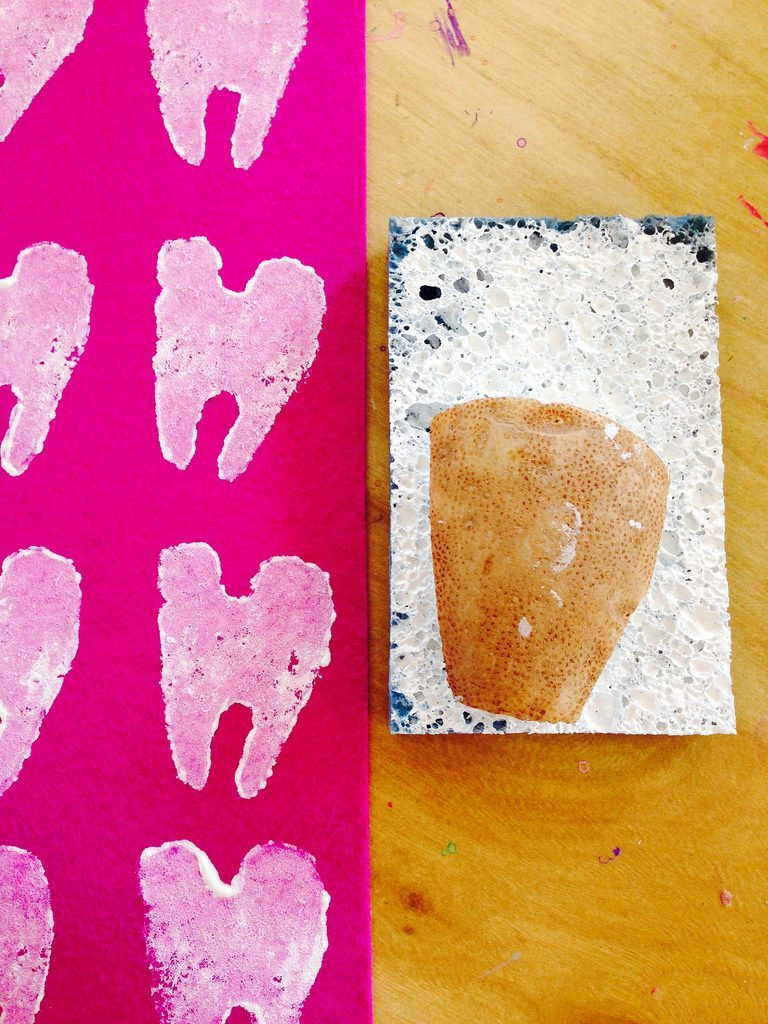 Ink your potato stamp with a paint filled sponge.