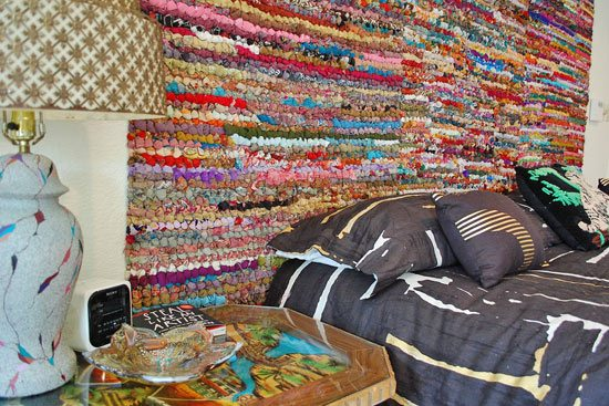 How to make a DIY headboard from colorful rag rugs by Jennifer Perkins.