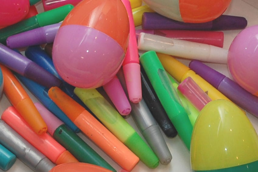 Supplies for painting plastic Easter eggs with puffy paint
