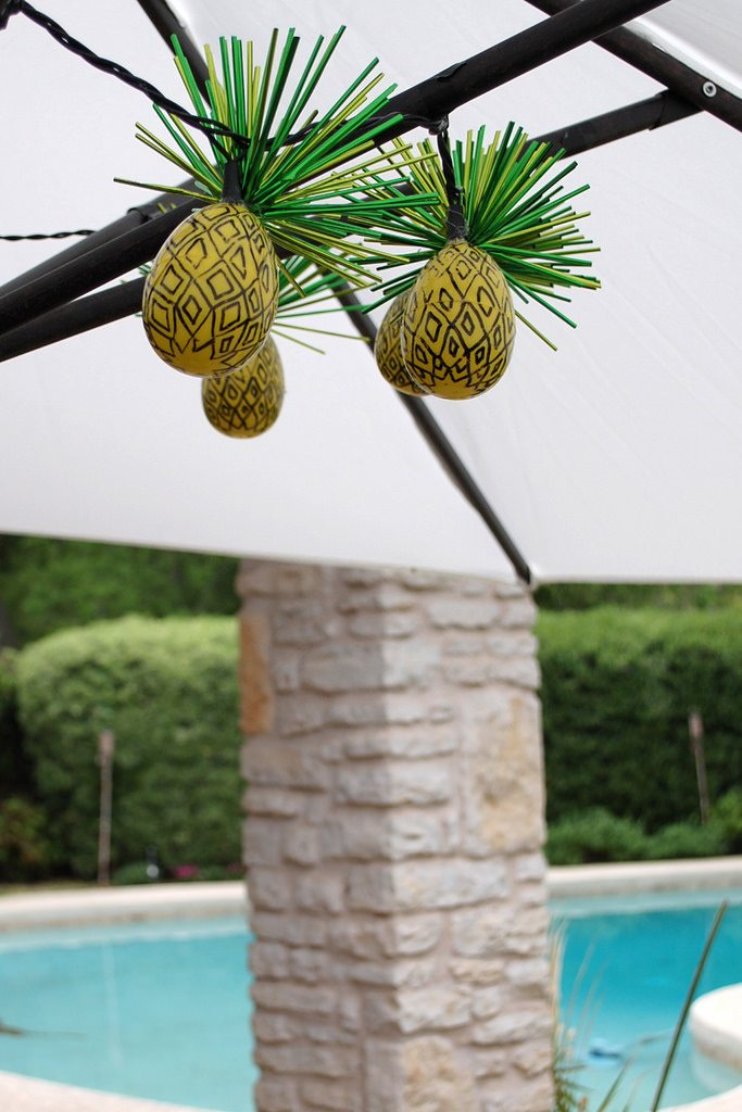 Turn plastic yellow Easter eggs into pineapple string lights by the pool.