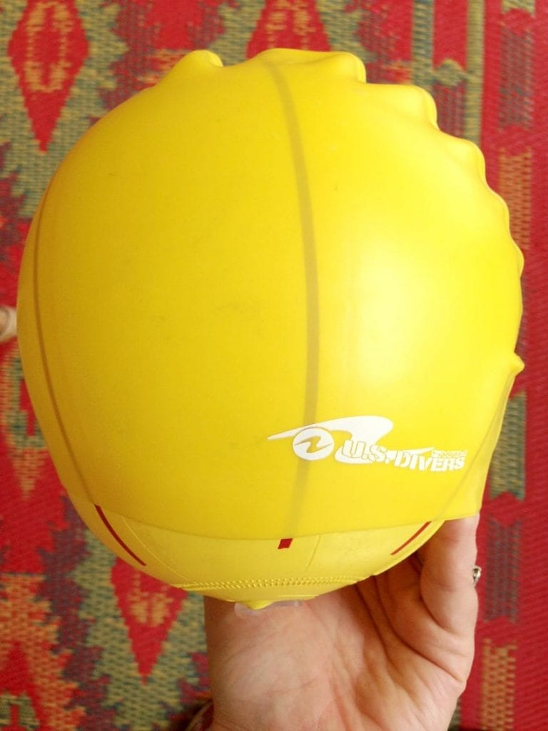 yellow swim cap stretched over a ball