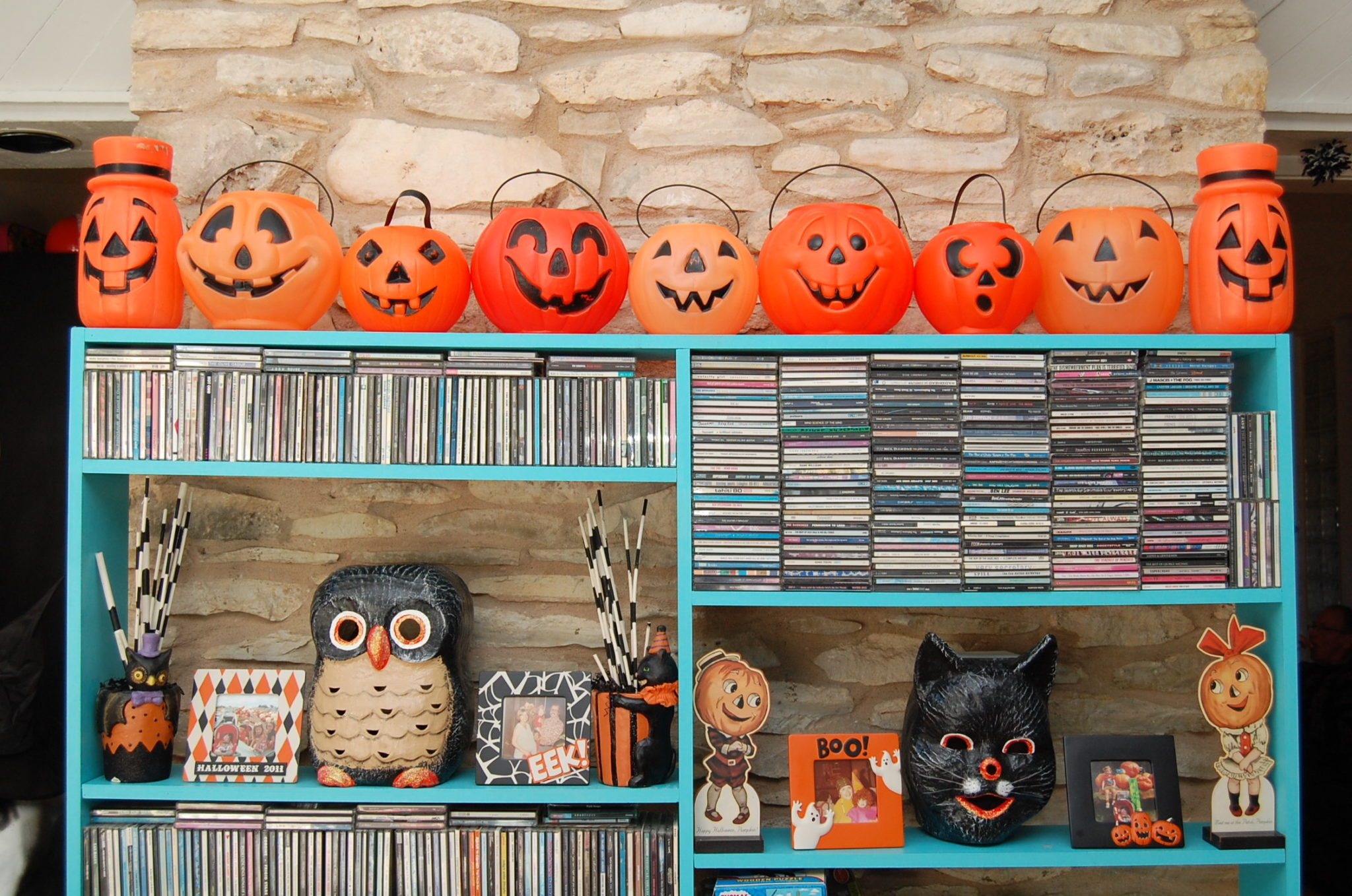 Plastic Halloween pumpkins on a shelf
