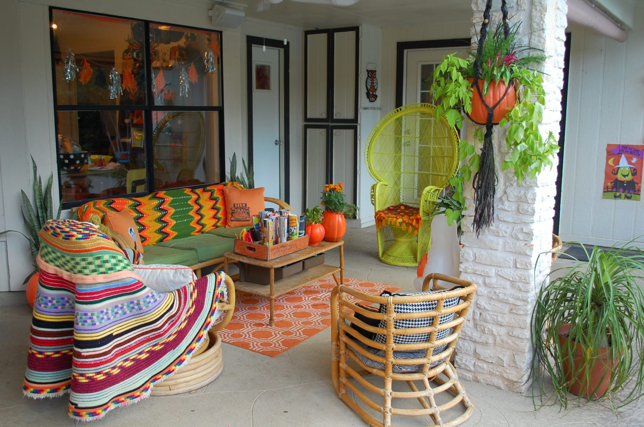 fall porch with afghans and pumpkins