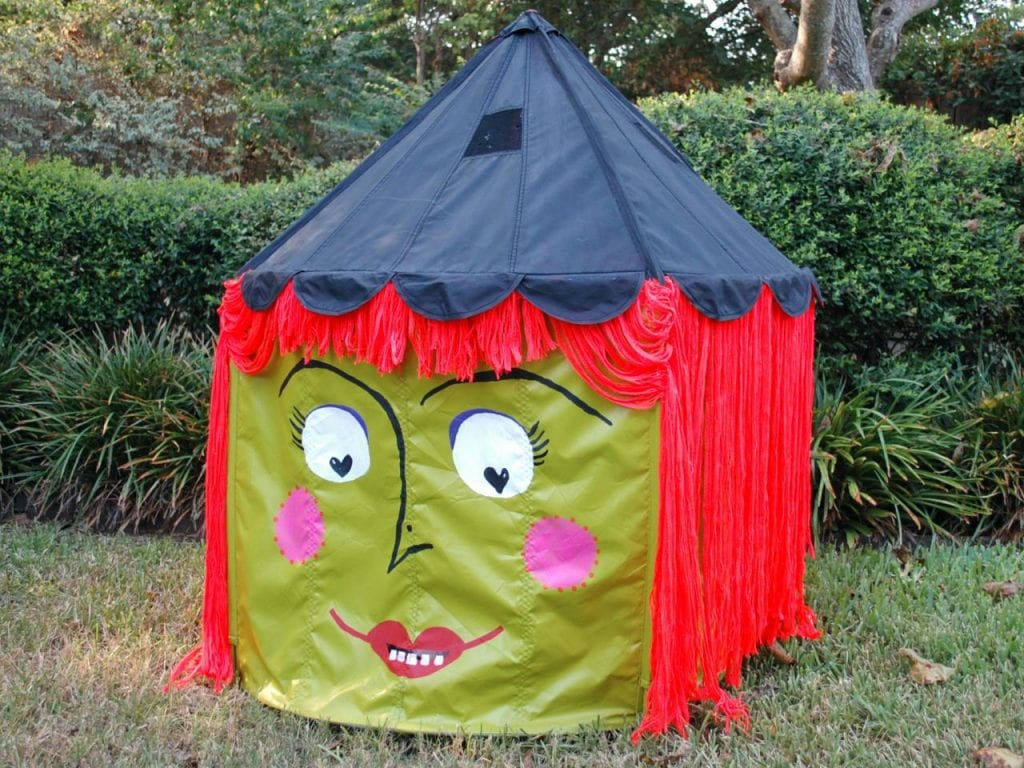 Kids tent painted green like a Halloween witch