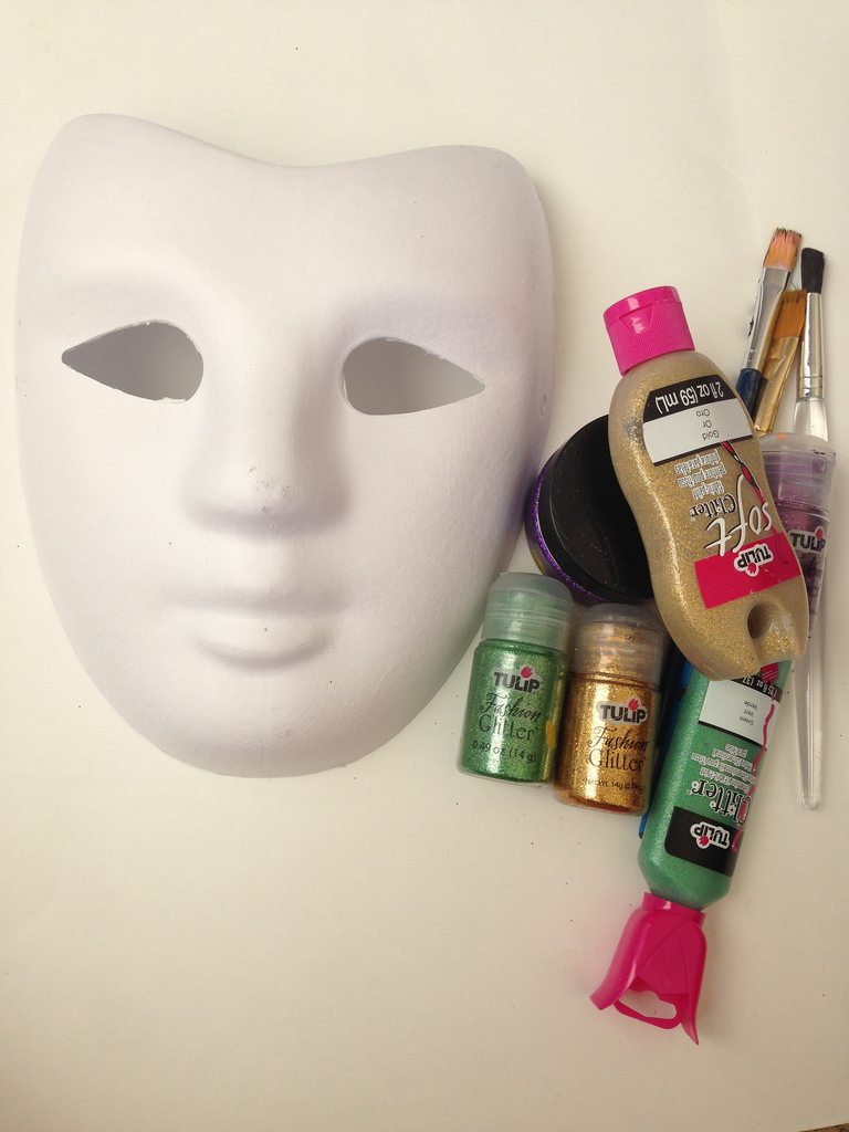 Supplies for making a green, gold and purple Mardi Gras mask by Jennifer Perkins