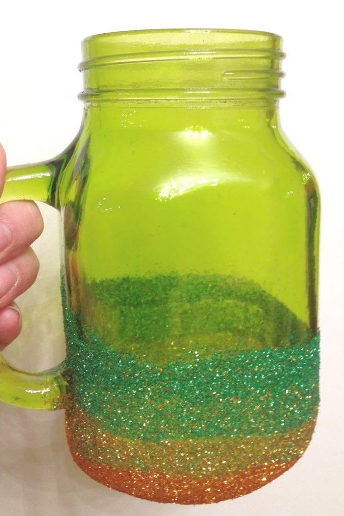 Green mug covered in ombre glitter