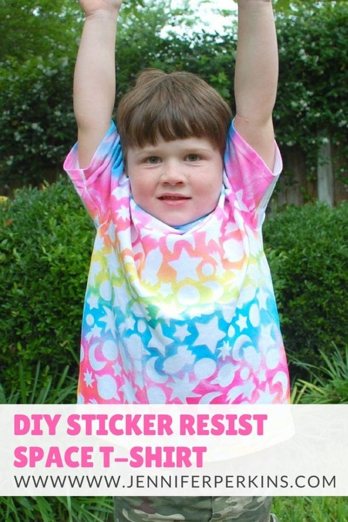 How to make a DIY space themed T-shirt for kids using stickers as a resist and fabric spray paint. - Jennifer Perkins