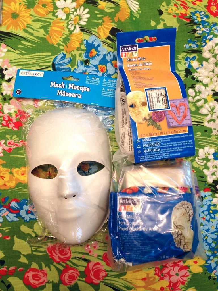 The supplies you will need to make a Halloween mask.