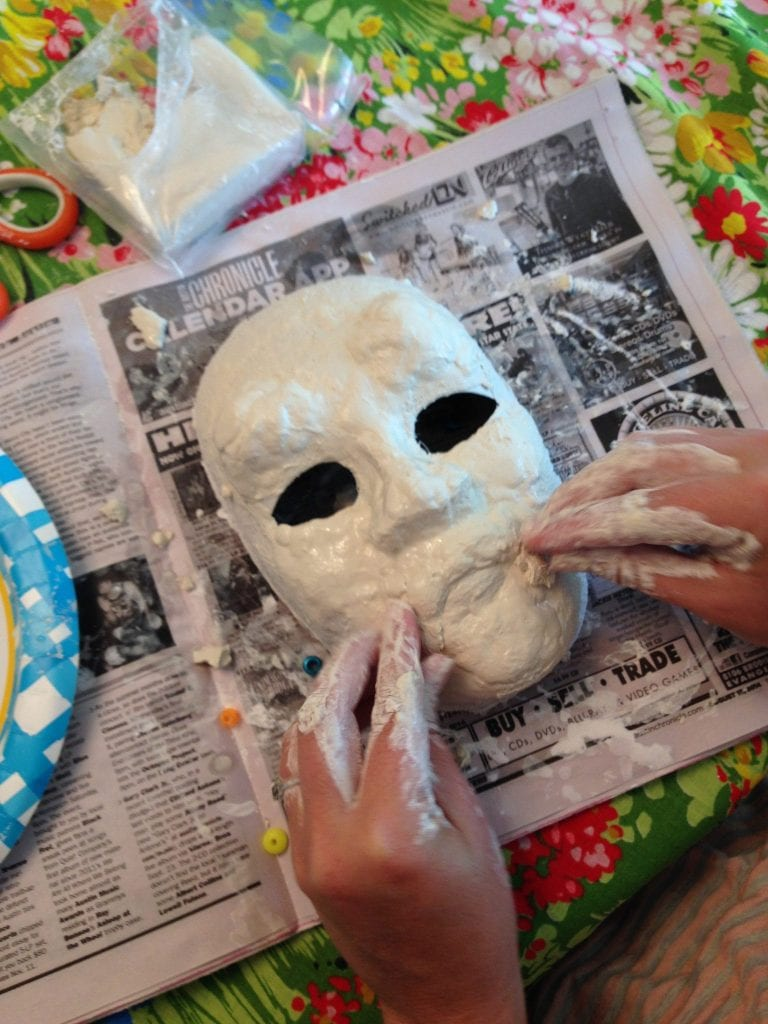 Apply air dry clay to your Halloween mask.