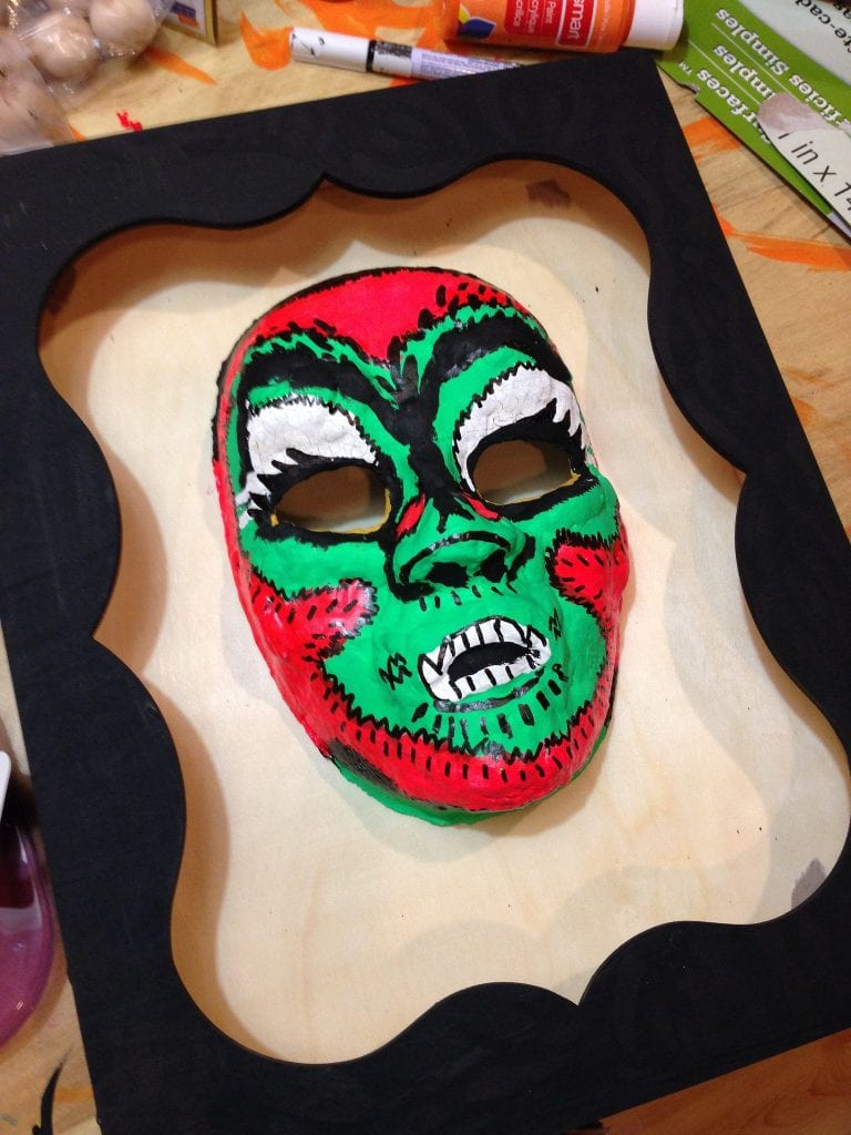 Add detail to your Halloween mask with paint.