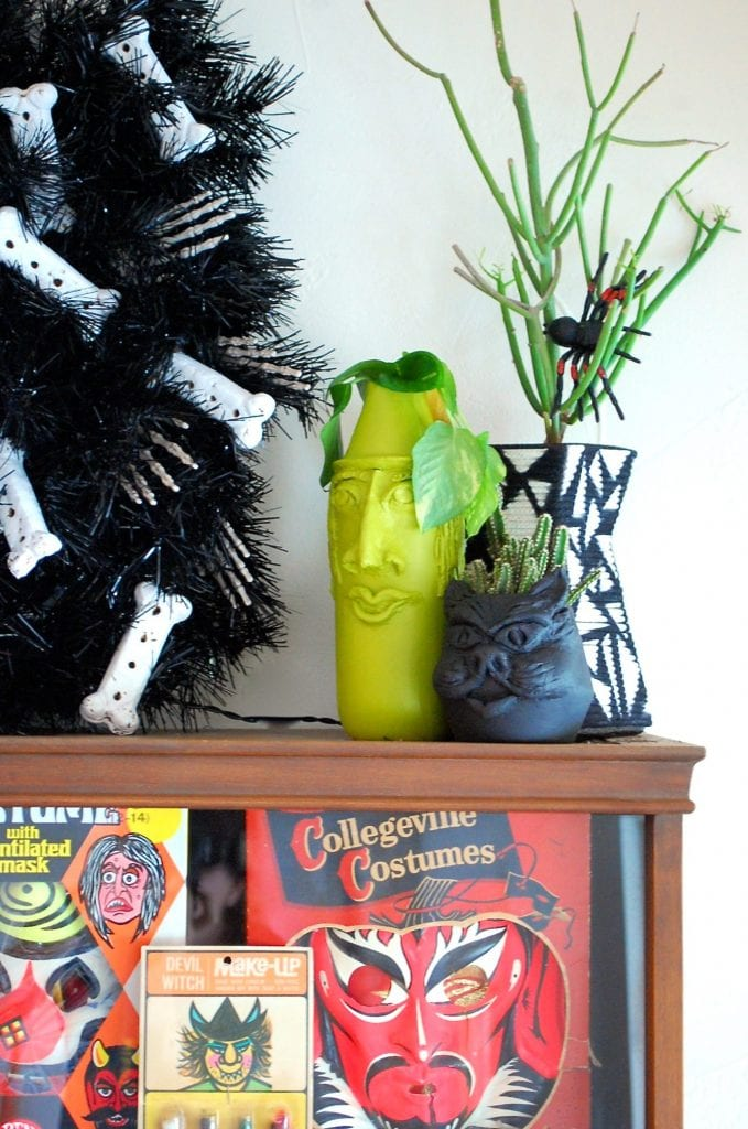 Halloween clay planters on a shelf.