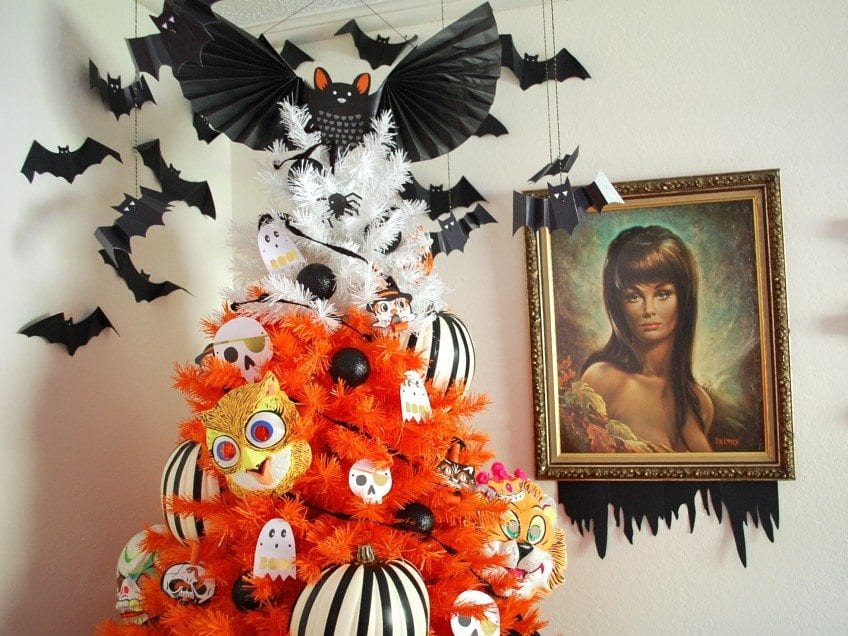 Bat tree topper on a Halloween tree.