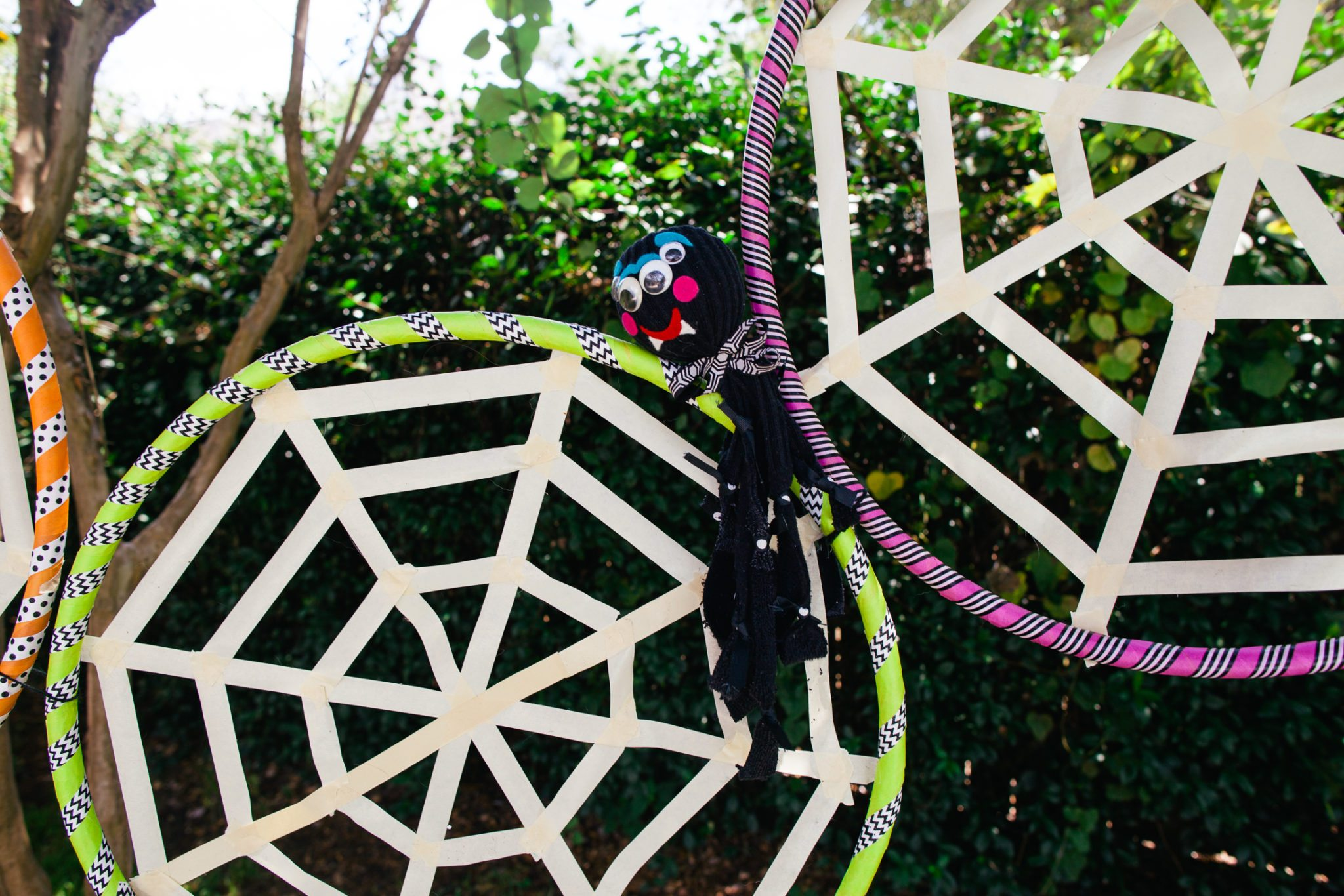 spiders made from socks for a Halloween spider web toss game.