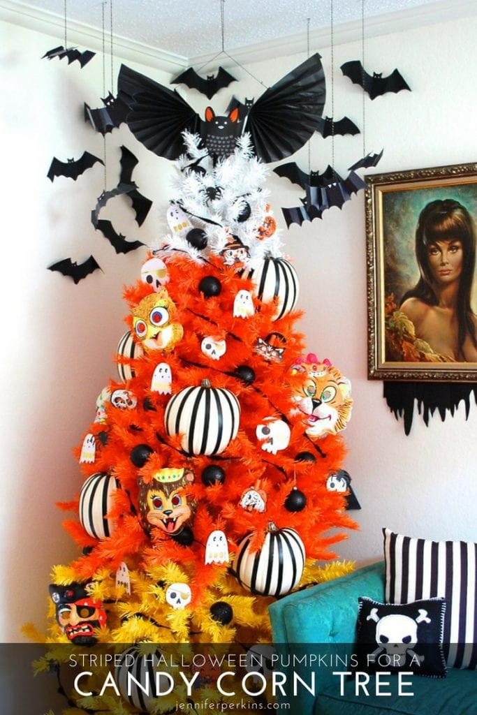 Halloween tree that looks like candy corn covered in striped pumpkins