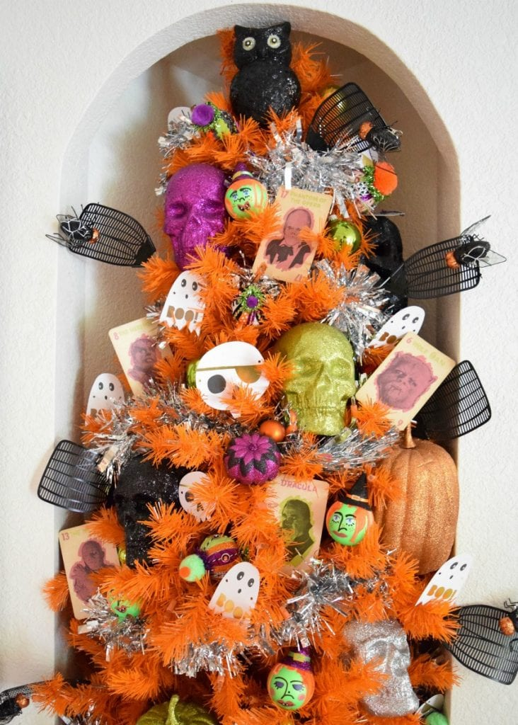 Orange Halloween Christmas tree with skulls witches and fly swatters