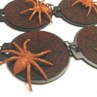Sparkly orange spiders on DIY stenciled web ornaments for a Halloween tree by Jennifer Perkins
