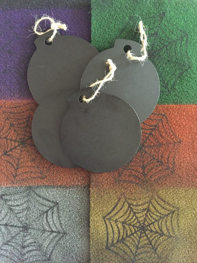 Stenciled spider webs for felt Halloween ornaments by Jennifer Perkins