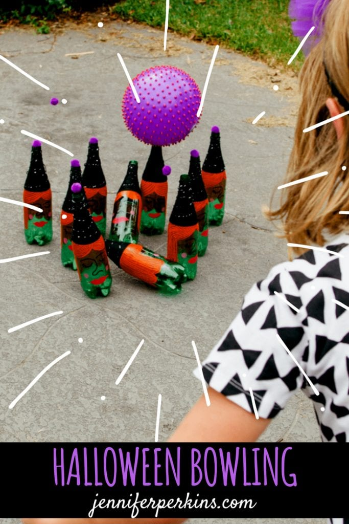 Child playing a round of Halloween lawn bowling