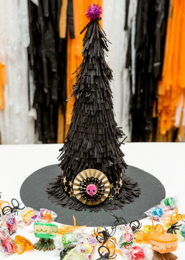 DIY piñata that looks like a witch hat with treats and candy