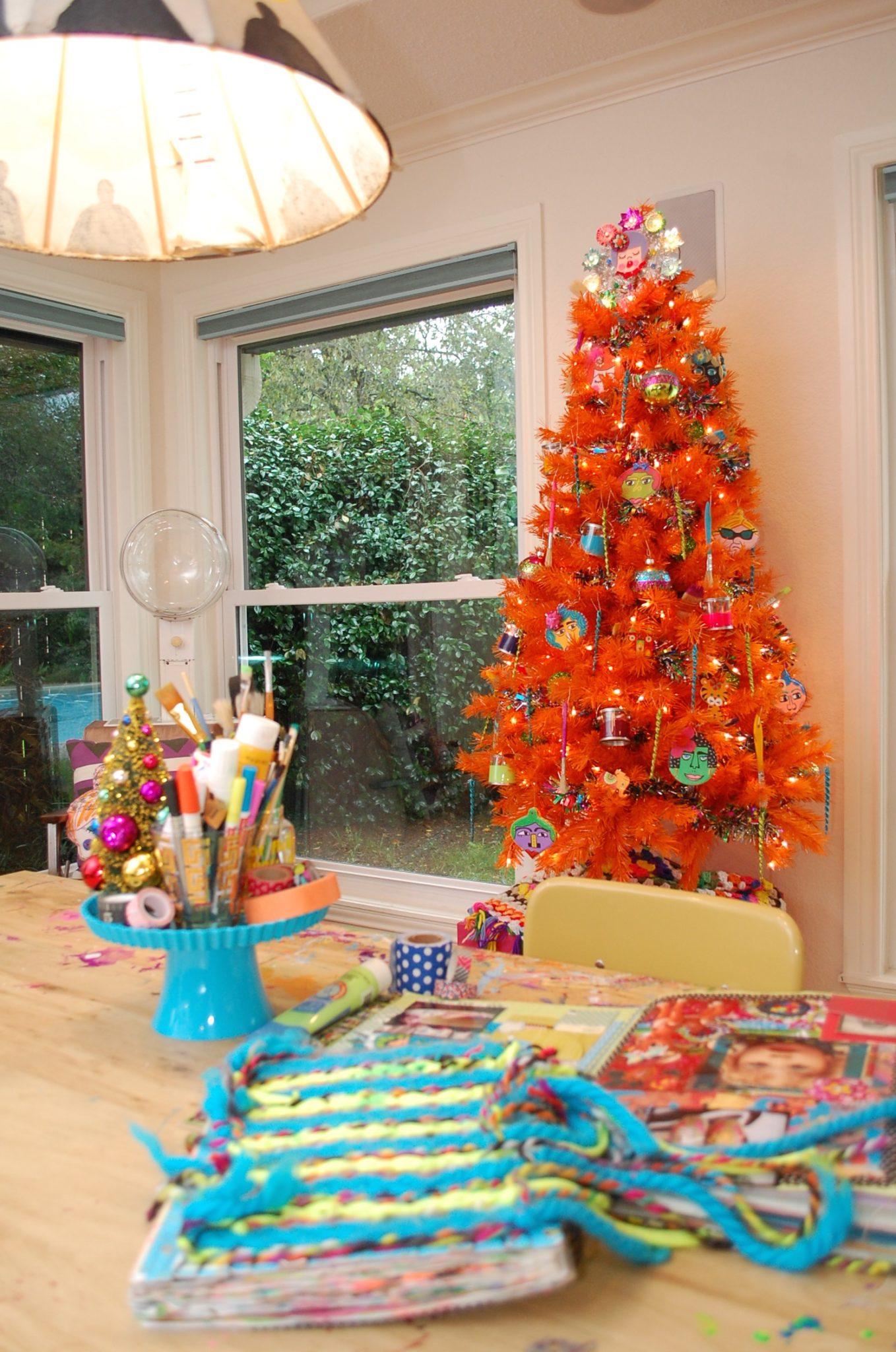Decorating an orange Christmas Tree.