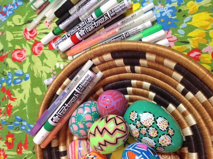 Using gel pens and paint markers on plastic eggs.