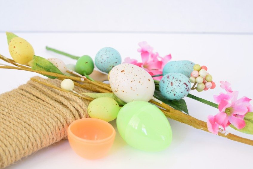 Supplies for making a nest necklace from a plastic Easter egg.