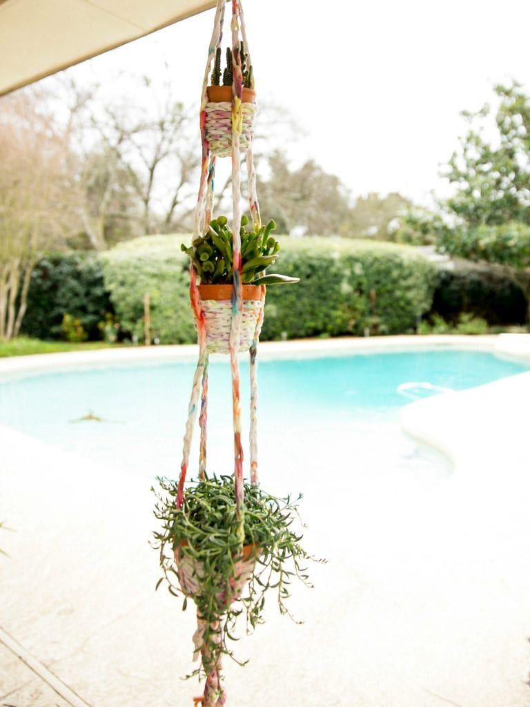 Triple strand hanging basket from a T-shirt.