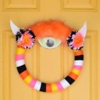 How to make a yarn wrapped Halloween wreath.