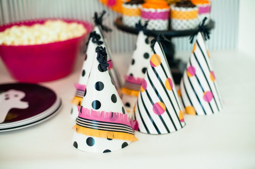 How to make fringed washi tape party hats.