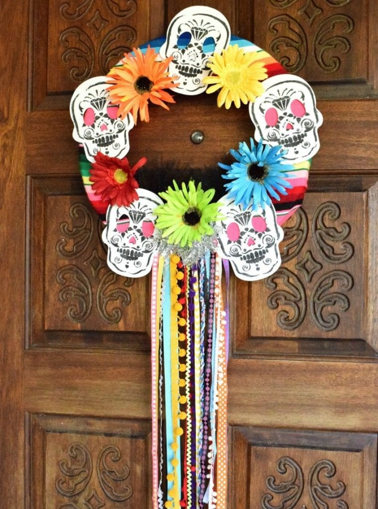Day of the Dead wreath with stenciled sugar skulls