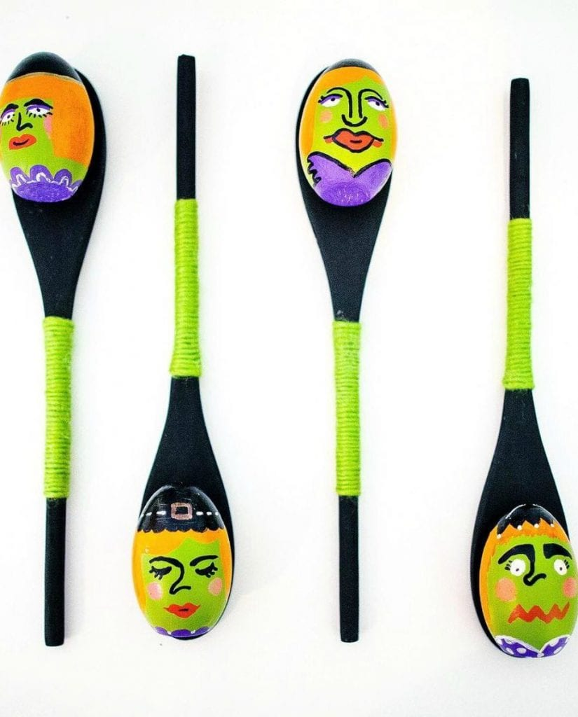 Wooden spoons painted with eggs that look like witches