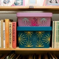 How to stitch onto plastic storage bins with yarn.