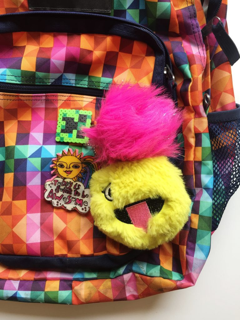 How to use a coloring book and Shrinky Dinks to make a backpack charm.