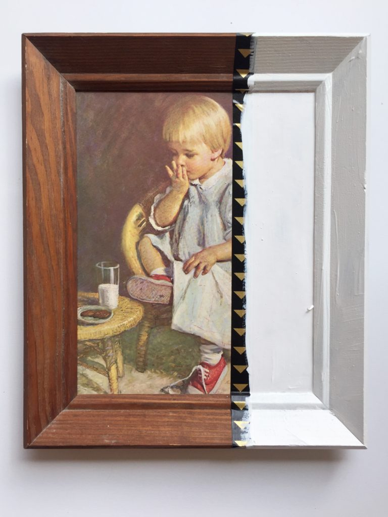 Adding paint to a piece of thrift store art.