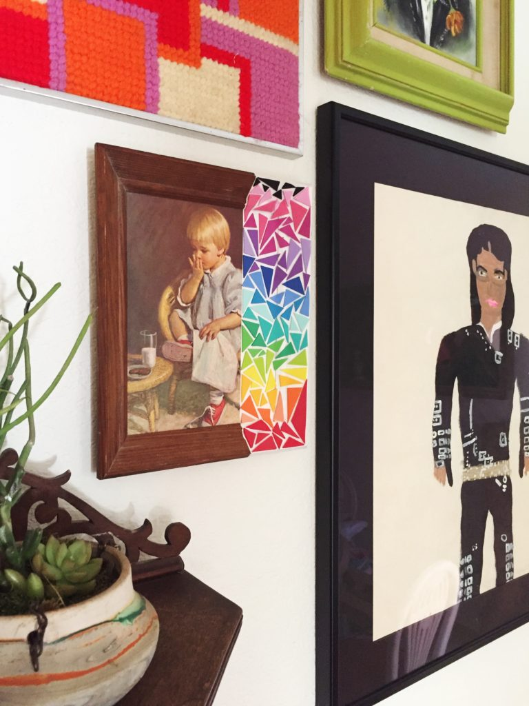 How to make thrift store art that much better with rainbow stickers.
