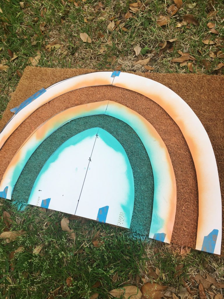 Making a stencil for a rainbow doormat.