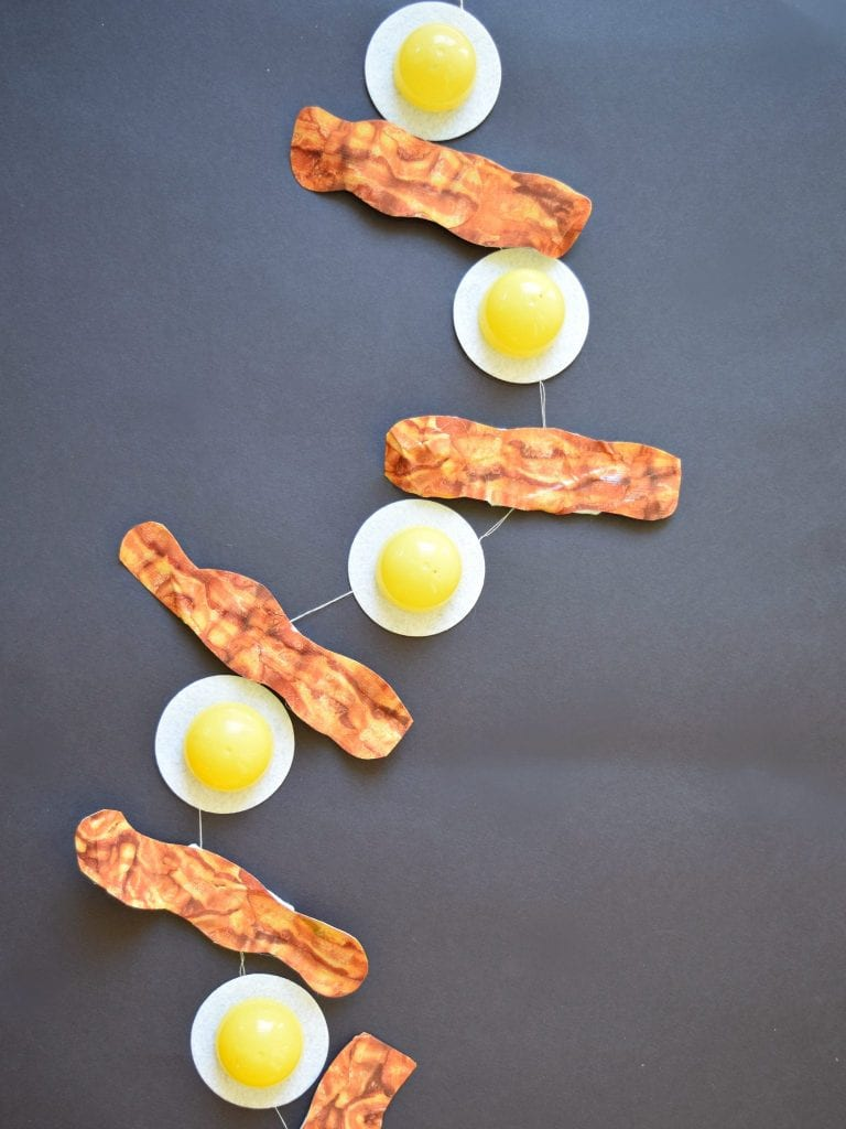 How to make a bacon and egg banner using Duck Tape and left over plastic Easter eggs by Jennifer Perkins