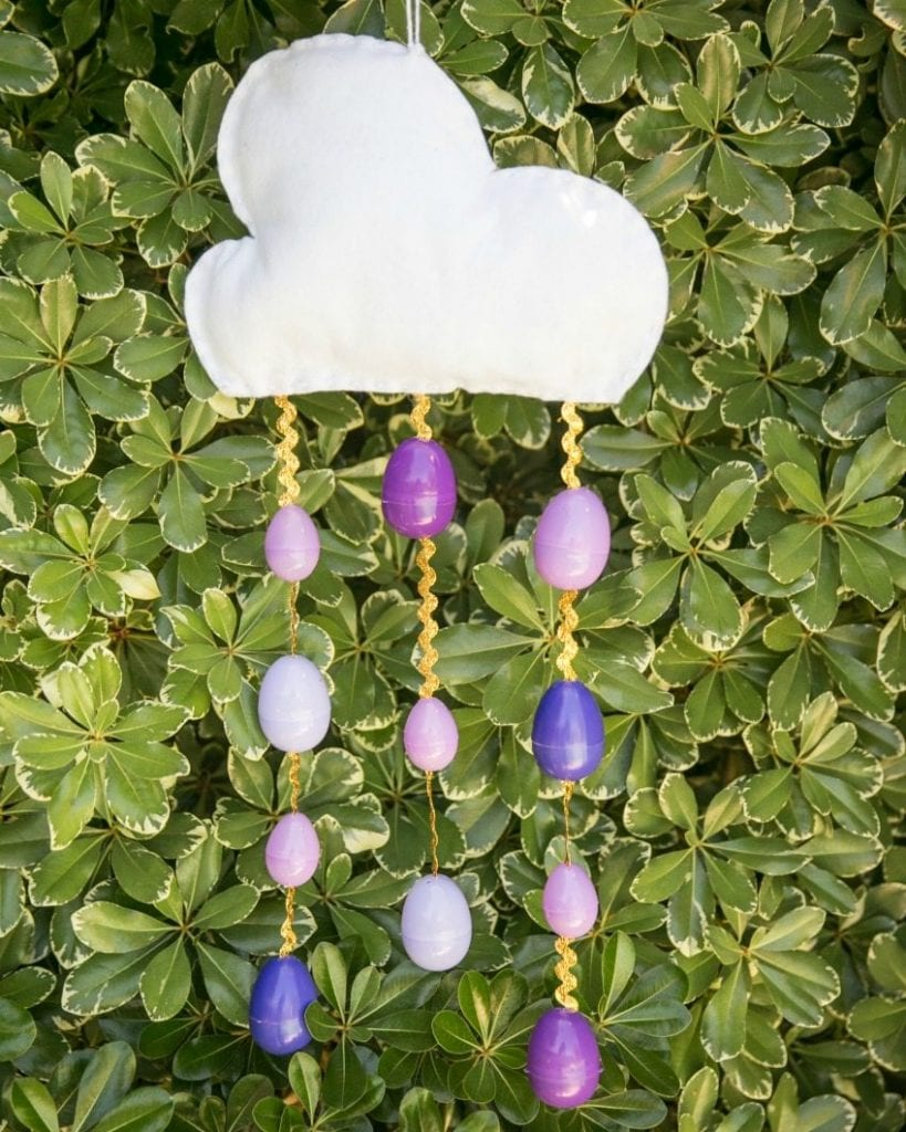 Cloud mobile with purple rain from Easter eggs.