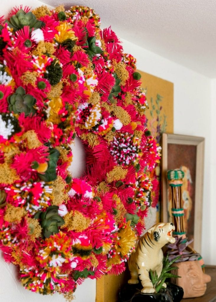 Hot pink wreath full of pompoms.