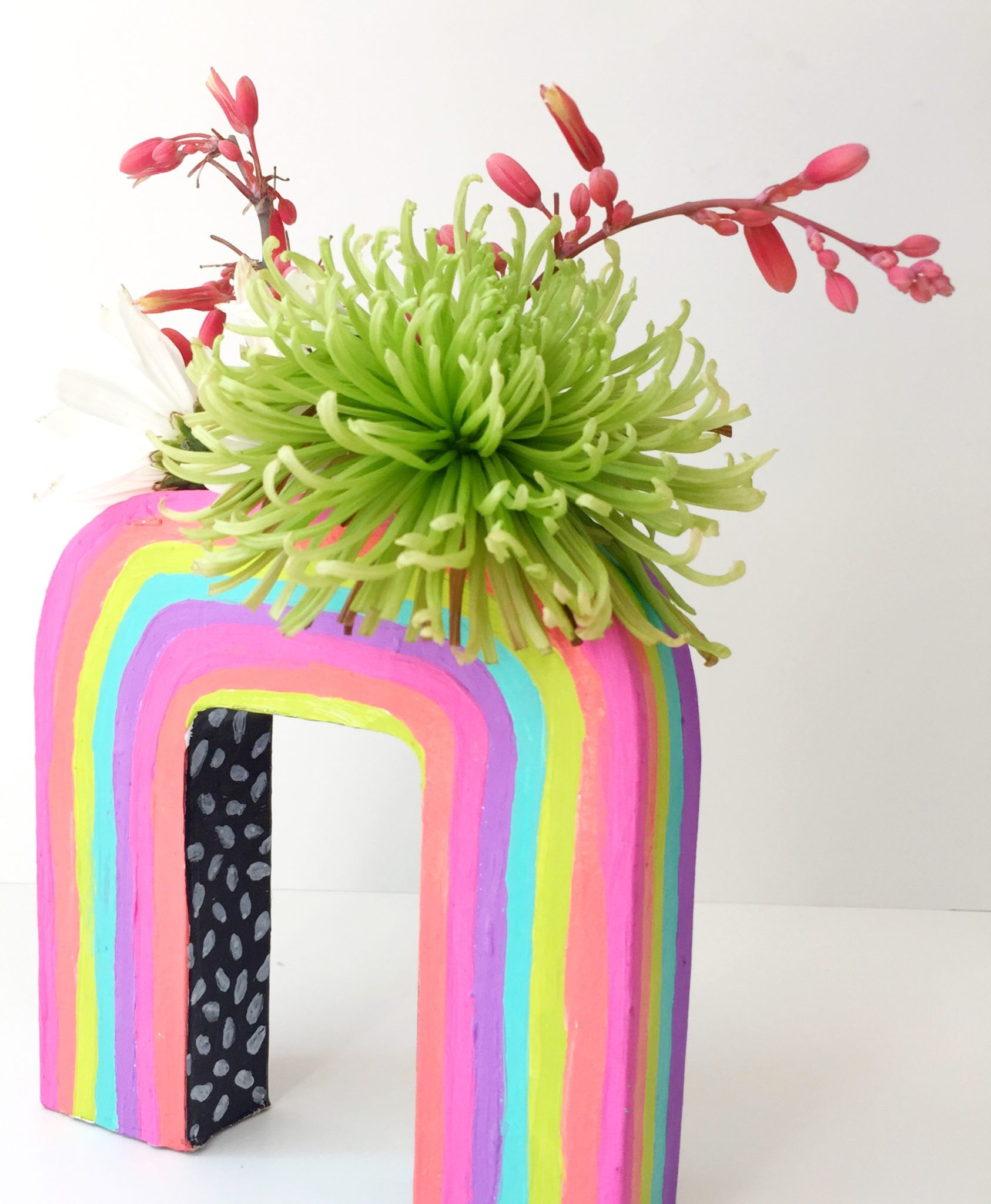 Colorful rainbow vase from a cardboard letter U by Jennifer Perkins