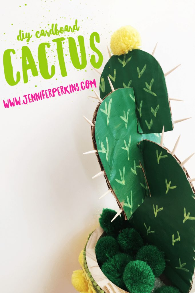 Cactus plant in pot made from cardboard and paint