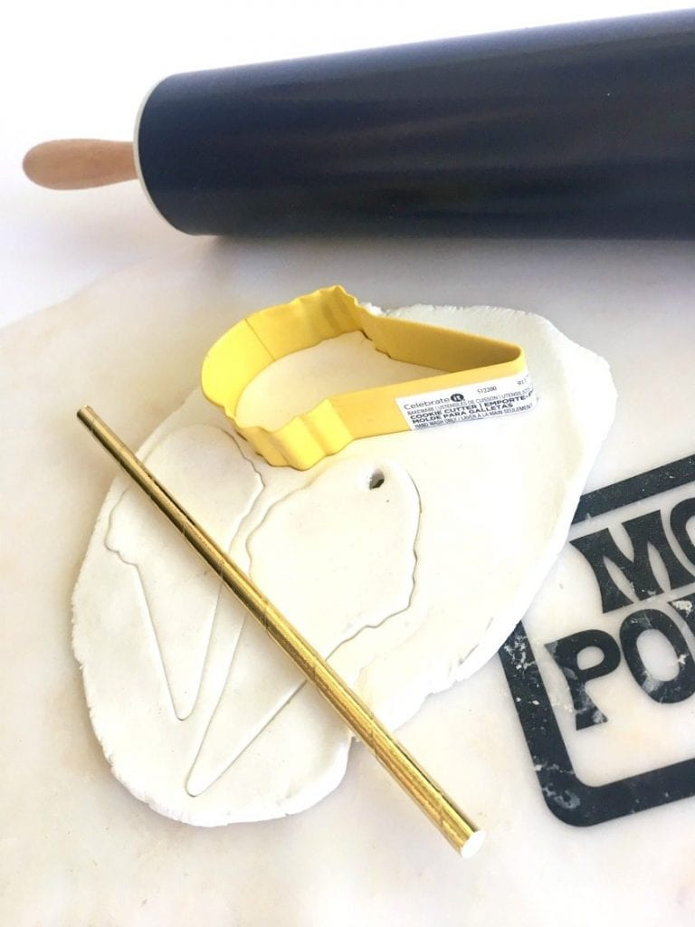 Rolling out clay to cut with ice cream cone cookie cutter by Jennifer Perkins